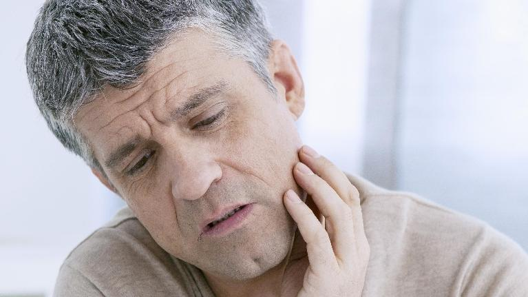 Man with Tooth Pain | Bethlehem Town Family Dental | Glentown, NY