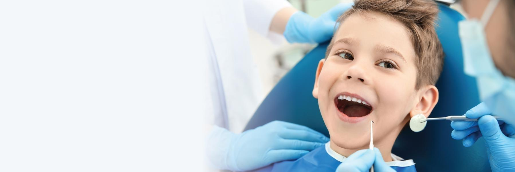 Child smiling at the dentist office in Glenmont, NY