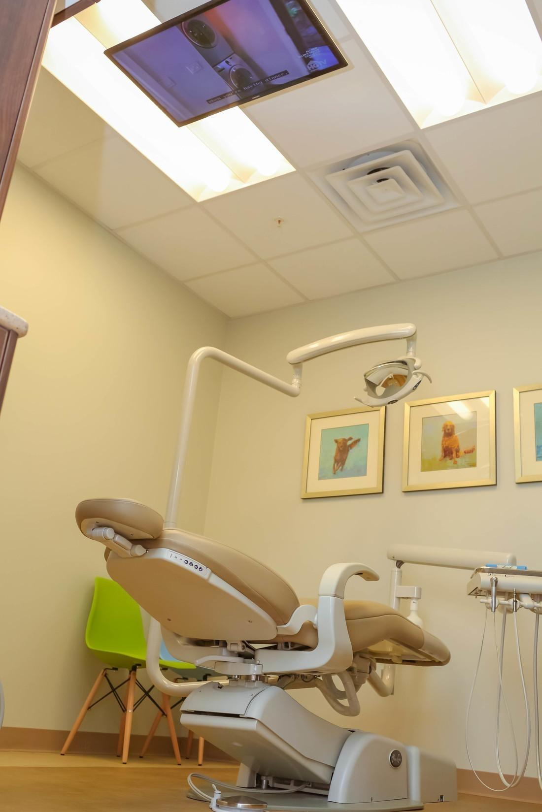 Exam room with a TV at Bethlehem Town Family Dental in Glenmont, NY